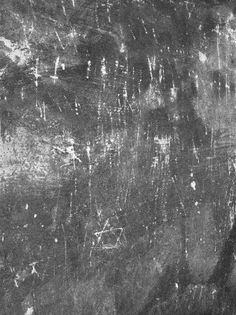 This is something we really do not like. The picture shows the wall of the former gas chamber of Auschwitz I. Unforunatelly tourists - throughout the yers - left many signs of their misbehaviour which cannot be called otherwise as vandalism. Yet, some people present this photo as nail scrach marks left by the victims which is pure emotional manipulation!