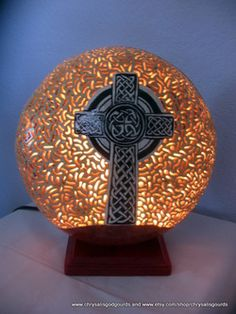 """Celtic Cross Luminary...about 10.5"""" tall and 10"""" in diameter.  Has an electric cord and easily changeable light bulb inside."""