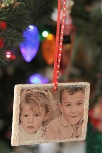 personalized DIY photo ornaments for cheap >> MADE IT!  used round wood pieces that cost $.29 each (I have 4 kiddies) so thats $1.20.  Already have mod podge at home and I used wallet size school pics, cut them all pretty with the style edge scissors.