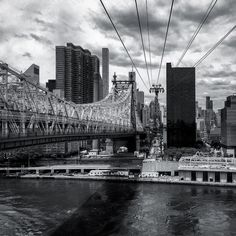 Mid-crossing on the Roosevelt Island Tramway. The black and white conversion really brings out the beautiful truss work of the Queensboro Bridge. #feelinggroovy #59thstreetbridge #queensborobridge #edkochqueensborobridge #blackandwhite #rooseveltisland #rooseveltislandtramway #nyc #newyork #newyorkcity #ig_great_shots_nyc #ig_nycity #summerinthecity #what_i_saw_in_nyc #wildnewyork #bridges_of_our_world #bridges_aroundtheworld #seeyourcity #newyork_instagram  #newyork_ig #icapture_nyc…
