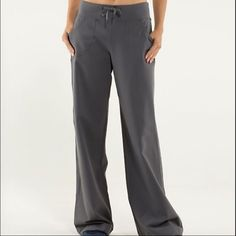lululemon athletica wide leg grey pants size 6 These pants are in excellent condition! Only wore a couple times. They just aren't the right size for me. No pilling. Two front pockets. Drawstring waist. Wide leg. 11 inch rise. 31 1/2 inch inseam. Smoke free home. lululemon athletica Pants Wide Leg