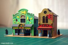 Papercraft models of theme park structures from Spirited Away.