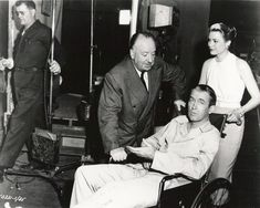 REAR WINDOW (1954) - Alfred Hitchock, Jimmy Stewart, and Grace Kelly