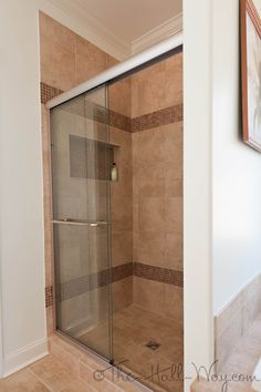 Master Bathroom - Tile Shower with Merola Coppa Tan Glass Tile accent from Home Depot, Wall color - Valspar Ocean Buff