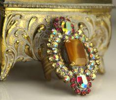 Adjustable cocktail statement ring. Brilliant iridescent pink crystal rhinestones with caramel center. Textured brass wide band. ModernRenaissanceMan