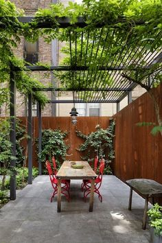 Stunning Revival of a NYC Townhouse by O'Neill Rose Architects The outdoor space is anchored by a custom steel trellis.The outdoor space is anchored by a custom steel trellis. Wooden Pergola, Outdoor Pergola, Backyard Patio, Backyard Landscaping, Backyard Ideas, Diy Pergola, Patio Ideas, Metal Pergola, Garden Ideas
