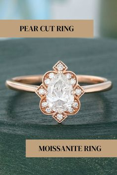 Pear Shape Stylish Moissanite Diamond Ring, Rose Gold Victorian Style Ring, 14K Unique Round Cluster Diamond Ring, Dainty Art Deco Ring ✥ Description Of Ring :- ✥ Center Stone Details :- • Moissanite Details :- • Center Stone Shape : Pear Cut • Center Stone Weight : 0.70 CT • Center Stone Measurement : 5.00*7.00 MM • Center Stone Color : White • Mohs Scale : Moissanite 9.25 • Refractive Index : 2.65 (Moissanite)