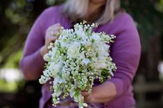 Lily Of The Valley, white sweet peas, white lilac, and white ranunculus