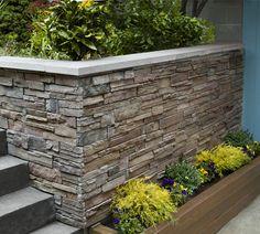 Use cast-concrete stone-veneer panels and masonry screws to dress up a plain wall