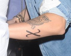 EXCLUSIVE: Justin Bieber reveals a new tattoo whilst partying in London