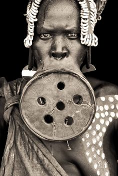 african portraits by mario gerth  Dama - mursi woman with enormous lip plate / omo