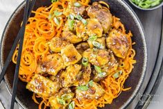 Sticky, sweet and savory crispy baked Honey Ginger Garlic Chicken over crunchy spiralized strands of carrot noodles are a match made in healthy, fake-out take-out heaven.