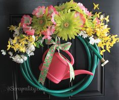 DIY Crafts | Make a pretty spring wreath out of a garden hose and watering can!