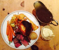 Sunday Lunch of roast Rib of Beef. Served with Beurre monte carrots with star anise; dripping roast potatoes and parsnips with rosemary; Yorkshire puds; trivet onion slice; horseradish sauce & Masala gravy.