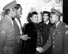 John W. Mosley - Jazz vocalist Billie Holiday meets a Sergeant at the South Broad Street U.S.O. after performance for servicemen, 1943