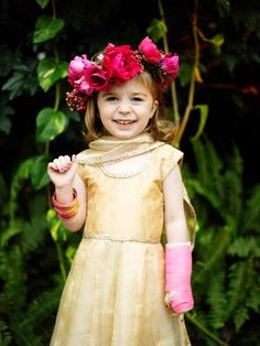 Floral design by Sullivan Owen, Photograph by Otto Schulze. Flower girl halo designed with hot pink garden roses.