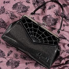 The Backseat Baby Purse has been reinvented in gorgeous, dark silver glitter vinyl with spiderweb embroidery. This classic Sourpuss handbag features a sturdy, vintage shape, satin lining, kiss-lock closure and easy grip handles. Luxury Purses, Luxury Handbags, Wholesale Handbags, Handbags On Sale, Monster High Halloween, Handbags For School, Silver Jewellery Indian, Silver Jewelry, Silver Rings With Stones