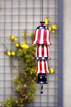 Listen to the sweet melody from the breeze and enjoy the patriotic touch this Stars and Stripes Ceramic Wind Chime adds to your porch or patio decor. It's great for the 4th of July and all summer long. #crackerbarrel