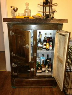 Old ice box restored into a chic dry bar. Been wondering what to do with my old ice box!!