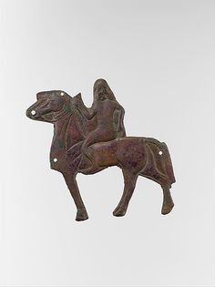 Plaque depicting a horse and rider Neo-Assyrian,ca 883-859 BC Mesopotamia, Bronze,traces of gold overlay Metropolitan