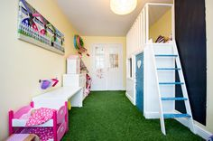 Bring the outdoors indoors! Kids playroom flooring: Artificial Grass - easy to wipe clean and vacuum.  Hard-wearing and doesn't show stains/marks!  Simply staple gun to the floor. Note: For indoor use ensure grass does not contain sand.
