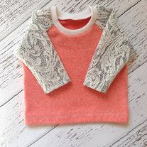 ++ More colors coming soon!++  The perfect sweatshirt for little girls! Raglan style sweatshirt with lace sleeves. Coral/pink body is made out of french terry knit fabric (sweatshirt fabric) and the sleeves are made out of a thick lace knit fabric. The sleeves are a little bit sheer in some par...