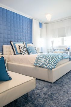 corrugated cardboard flats add texture and look like upholstering on walls in a modern bedroom by In-Two-Design