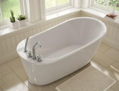 Maax 105797 000 Sax Elegant Small Sized Freestanding Soaker TubSoaking it all in with a bathtub fit for a small space    Small  . Small Freestanding Soaking Tub. Home Design Ideas