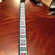 Native American design beaded guitar strap. It took approximately 8,675 beads to complete and this is a gift for our son Jerrod who plays lead guitar. It took approximately three months to complete and I must say Mark and I are very proud of our finished product!