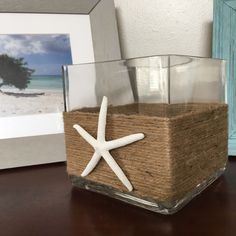 Starfish rope vase, nautical wedding centerpiece https://www.etsy.com/listing/493693534/twine-wrapped-starfish-vase-square
