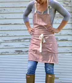 This apron is made from durable but soft striped mattress ticking fabric. Simple and rustic, this apron is perfect for use in the kitchen, Mug Rug, Ticking Fabric, Gardening Apron, Apron Designs, Cute Aprons, Linen Apron, Aprons Vintage, Retro Apron, Sewing Aprons