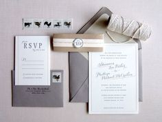 gray wedding invitation suite with hints of pale blush
