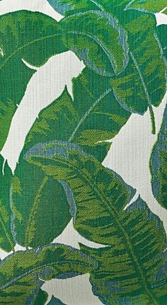 Our Amazon Emerald Outdoor Pillow features a pattern of oversized palm fronds in beautiful bold shades of green and blue. | Frontgate: Live Beautifully Outdoors
