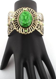 Two Pieces Ladies Bronze with Green Gemstone Style Bangle Bracelet JOTW. $0.01. This price is for TWO bangles!. 100% Satisfaction Guaranteed!. Great Quality Jewelry!