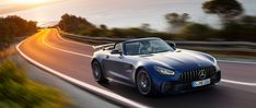 The new Mercedes-AMG GT R Roadster (R in designo brilliant blue magno in front view on a coastal road at sunset. Mercedes AMG GT S Back Pressure Points, Mercedes Amg Gt R, Forged Wheels, Second World, Coastal, Sunset, Blue, Sunsets, The Sunset