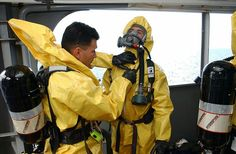 Nuclear, biological and chemical (NBC) disposal technicians taking part in a training exercise. Hazmat Suit, Hazardous Waste, Chemical Weapon, Emergency Management, Molecular Biology, Biochemistry, Video New, Us Navy, Marines