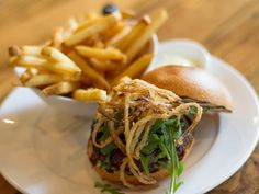The Louie Burger, topped with Cabernet bacon-onion jam, Maytag mousse, arugula and onions is just one of the mouth-watering items you can find at Chez Louie, a French dining destination, inside the Nevada Museum of Art in Reno.