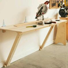 Wall table - would be cool hinged so it could be tucked away