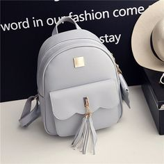 Item Type:Backpack Color:Grey,Black Material:PU Leather Weight:600 g Length: 25cm(9.84'') Height: 31cm(12.20'') Width:11cm(4.33'') Pattern:Solid Closure: Zipper Package Included: 1 * Bag
