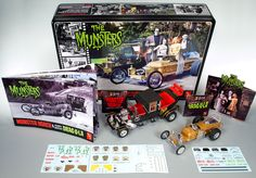AMT Models AMT 619 Munster Koach and Grandpa Munster's Drag-U-La- 2 Kits Collectible Tin) The Munsters are back! This Special Edition collector set features both the Munster Koach and the much requested Drag-U-La. The pair will come packaged in a full color tin featuring retro-style artwork. These are classic kits with enormous appeal and a big fun factor!