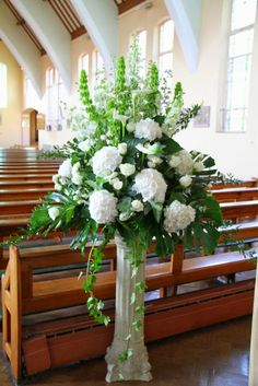 White Delphiniums, Green Molucella, Snowflake Roses, White Hydrangeas, Arum Lilies and Roses created these magnificent pedestal designs, the lovely ladies of the Church dressed the altar