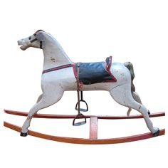 Antique Folk Art Child's Rocking Horse  American  19th century  Beautiful child's rocking horse in original paint, with a wonderful sculptural quality. 19th century, and a real charmer.