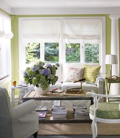 In the living room of this East Hampton beach house, painted a happy green, Ikea bargains—$6 roman shades and a $99 jute rug—stylishly coexist with a $1,695 eco-friendly sofa by Lee Industries. The reclaimed-elm table is from local shop English Country Antiques.    - CountryLiving.com