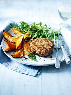 A lamb burger recipe spiced with chilli flakes and garam masala. Sweet potato chips and a green salad make the perfect accompaniments.