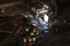 A bulldozer and municipality workers remove a barricade set up by protesters...