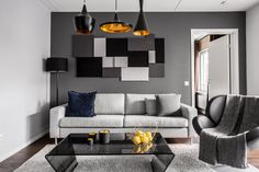 Appartment in Stockholm. Scandinavian interior design! Sofa from Bolia, table from BoConcept, lamps from Tom Dixon.