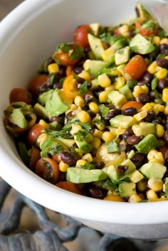 1 can corn kernels 1 cup chopped red onion 1 can black beans 1 cup grape tomatoes 4 oz. mixed greens 1 tablespoon olive oil 1 lemon zest and juice 2 tsp canned chipotle in adobo sauce (mince chipotle) Salt and pepper 1 avocado chopped 3 tbsp finely chopped fresh cilantro