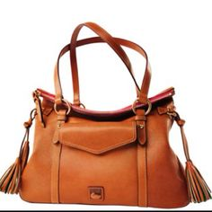 Dooney  Burke classic style all leather handbag with tassels