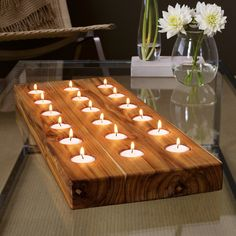 Forget electricity and let nature do all the work with the Rustic Takara Wood Tealight Display. Holds up to 18 votive candles. Find the Tealight Display, as seen in the #limited: Bed & Bath Collection at http://dotandbo.com/collections/10-hour-treasure-hunt-limited-bed-and-bath?utm_source=pinterest&utm_medium=organic&db_sku=DIM0015-tea