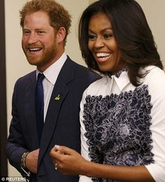 Prince Harry salutes wounded heroes of Iraq and Afghanistan all smiles as he meets Michelle Obama at event in support of Invictus Games | Daily Mail Online